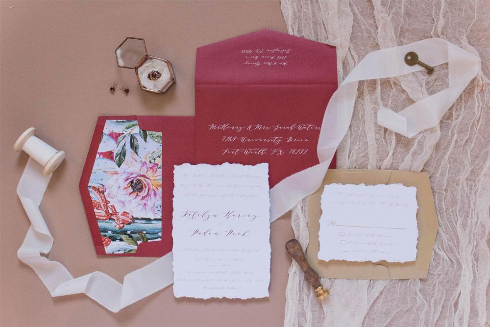 Calligraphy Style Romantic Red and Gold Wedding Invitation with Desert Inspired Envelope Liner